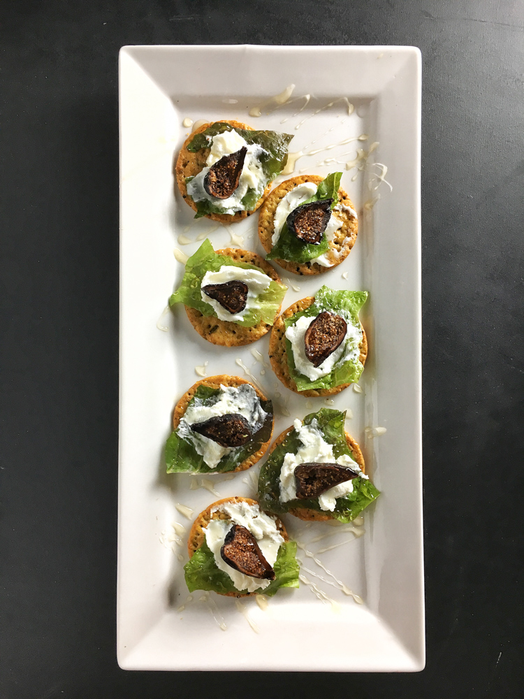 Easy-to-make appetizer: mini fig and goat cheese salads on top of Breton crackers. Recipe at Teaspoonofspice.com