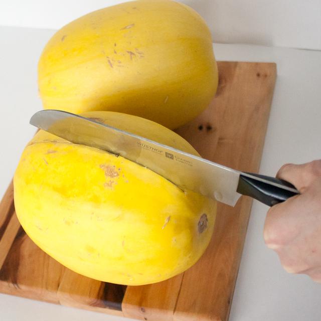 Easily cut through the tough skin of a spaghetti squash | @TspCurry For more #HealthyKitchenHacks - TeaspoonOfSpice.com