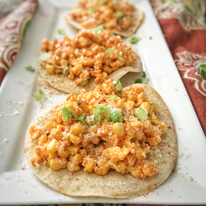 The famous grilled Mexican street corn meets eggs and tortillas in this breakfast mash-up recipe. Recipe at TeaspoonofSpice.com