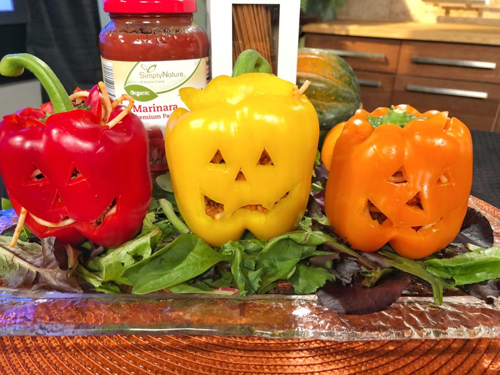 Carve up bell peppers and stuff them with spaghetti and meat sauce for Halloween. #sponsored #aldi #halloween #recipes